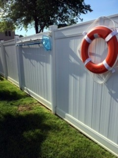Dave S. - Hooks on White Vinyl Fence